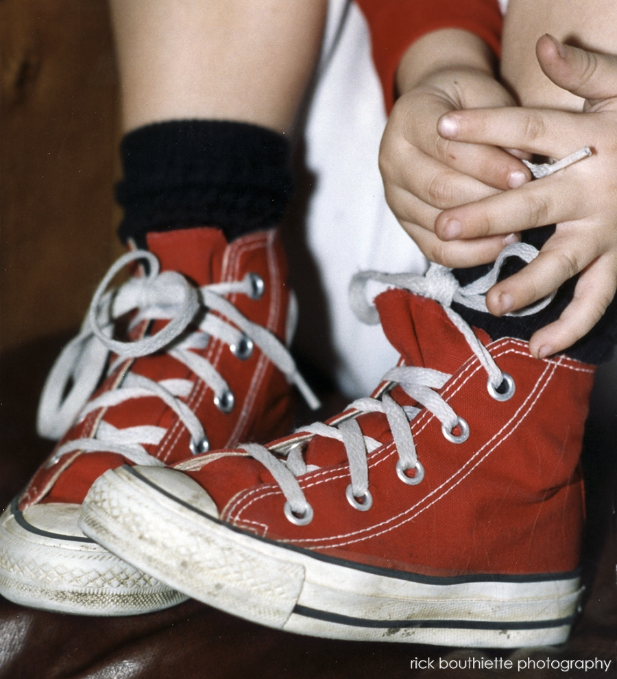 red converse sneakers on little boy