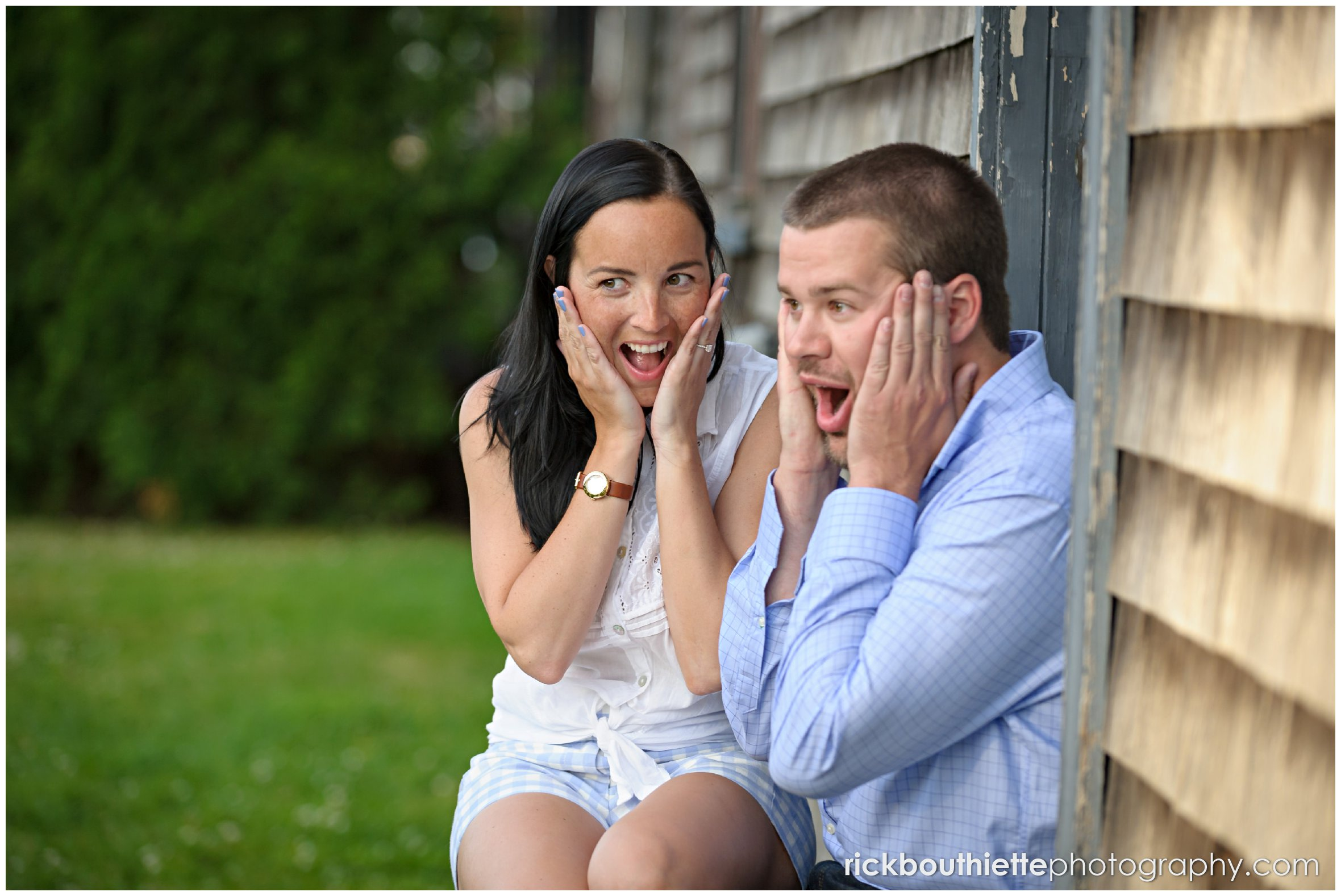 couple sharingfun moment during seacoast engagement session