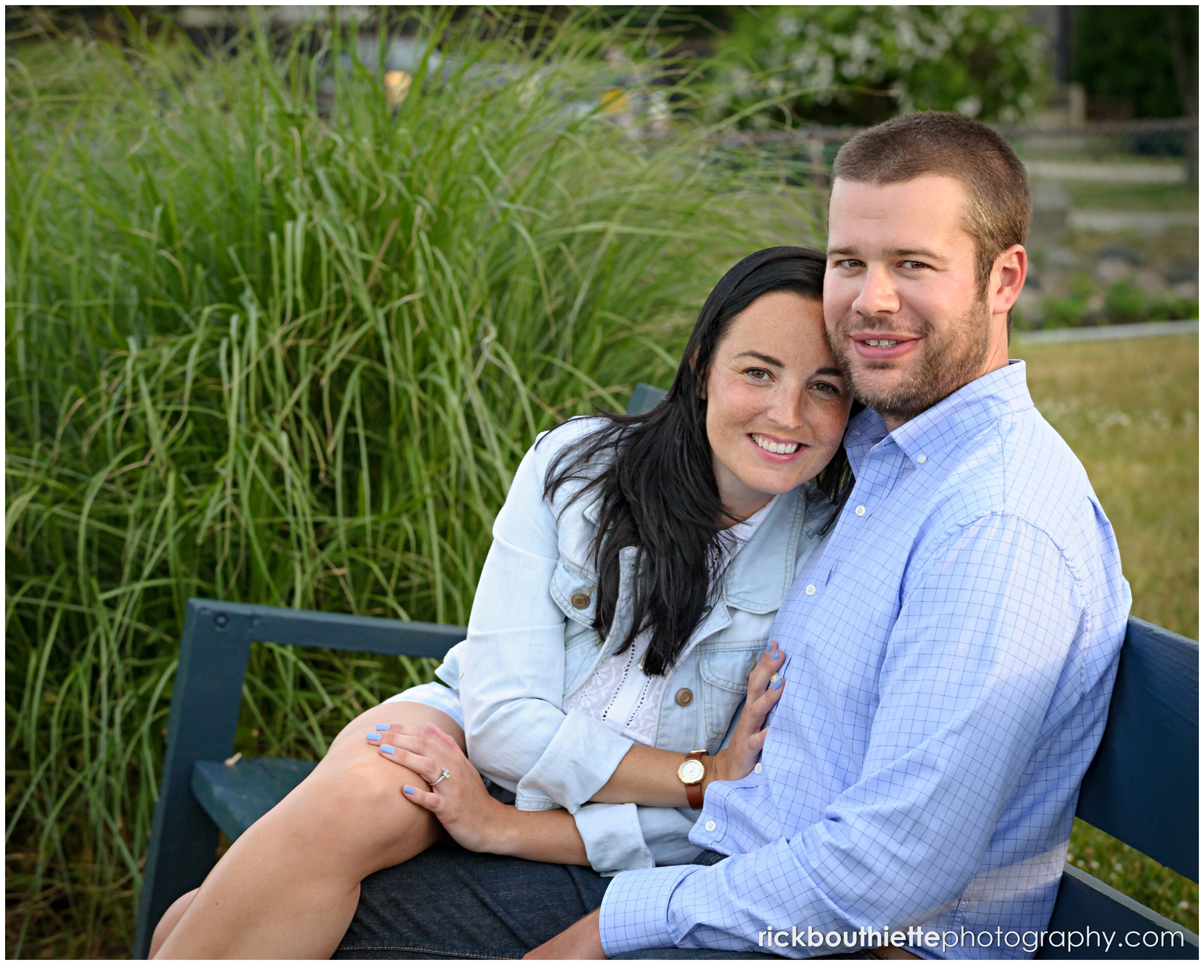 couple on bench in Prescott Park during seacoast engagement session