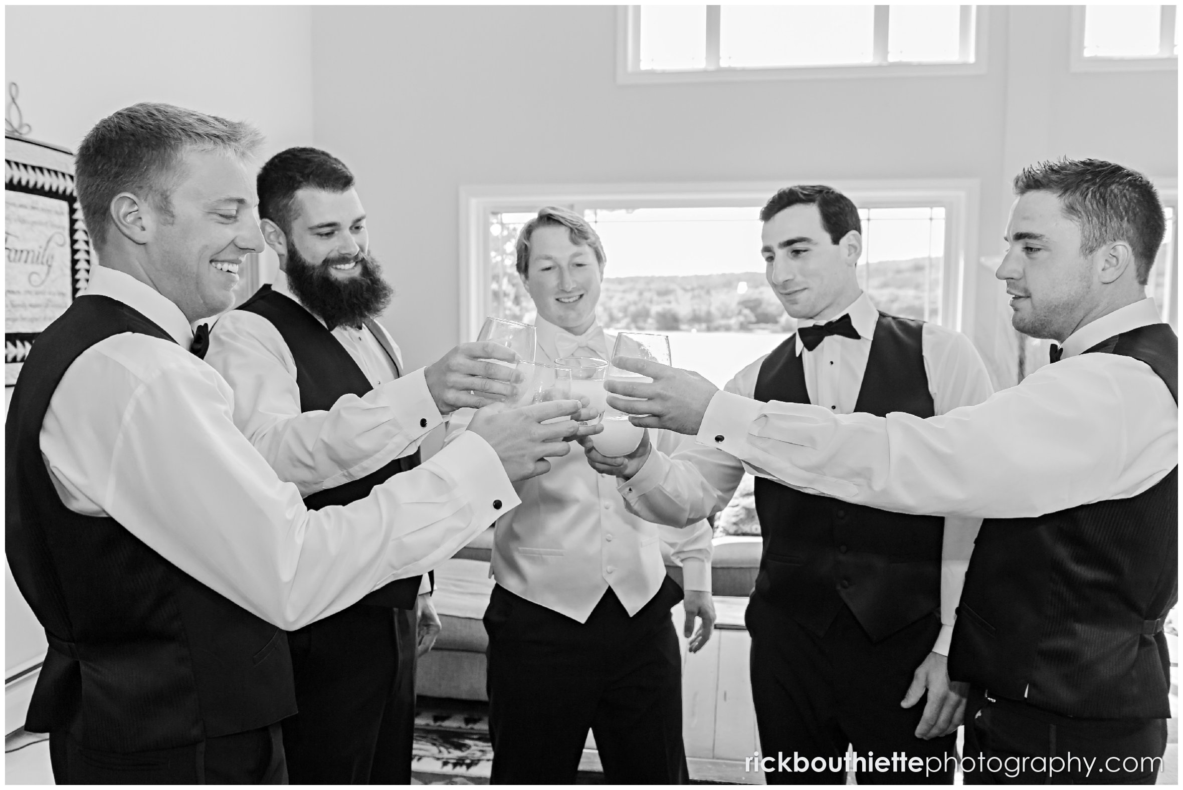 groom and groomsmen toast before Castle In The Clouds wedding