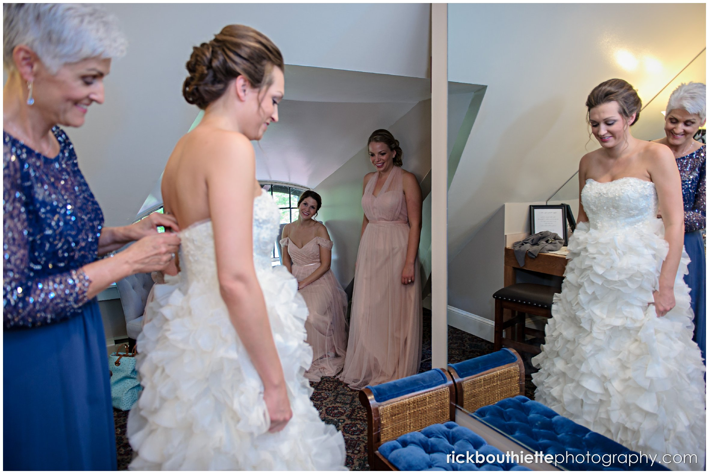 mother helping the bride get ready for her Castle In The Clouds wedding