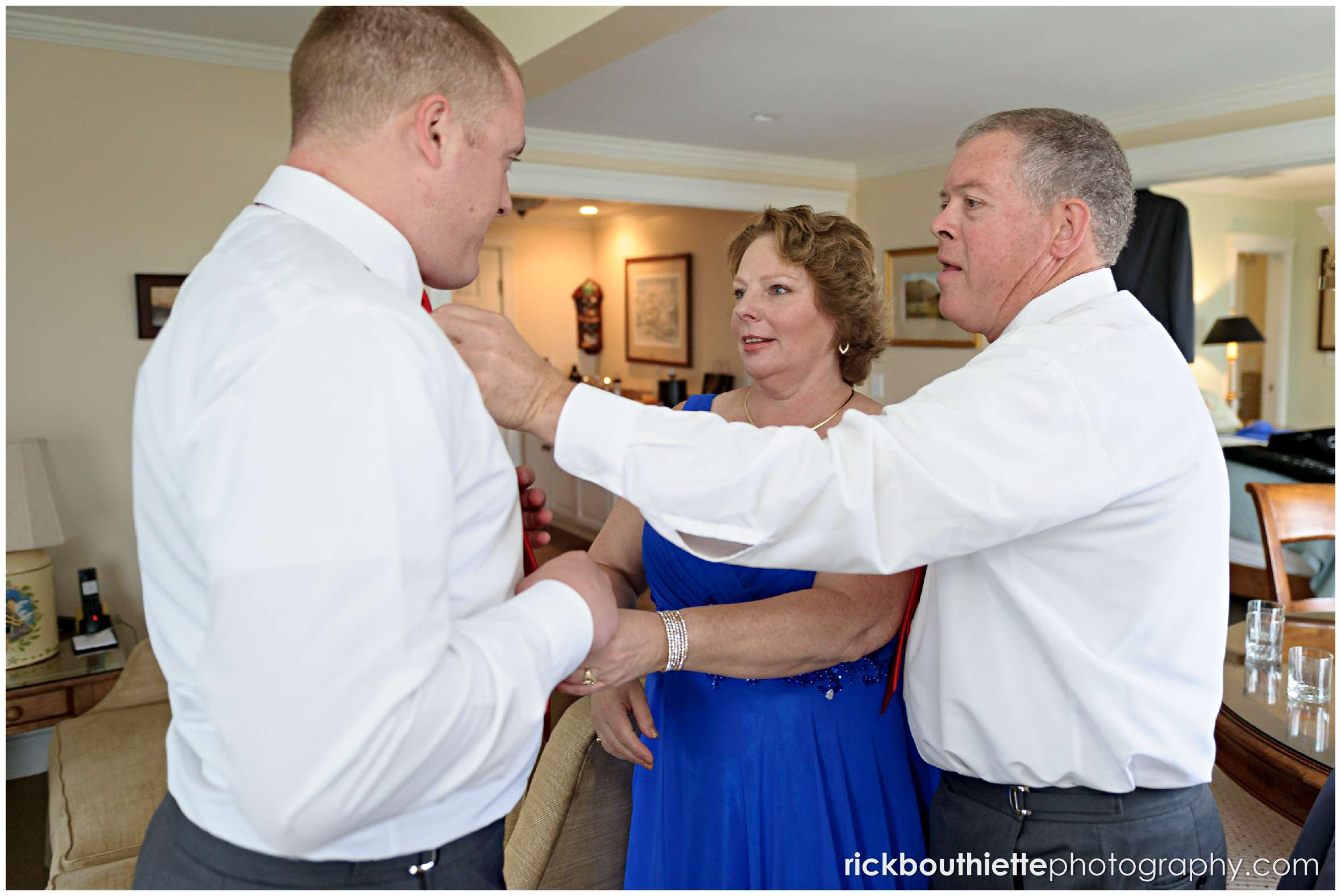 groom helped my parents as he gets ready for his wedding ceremony