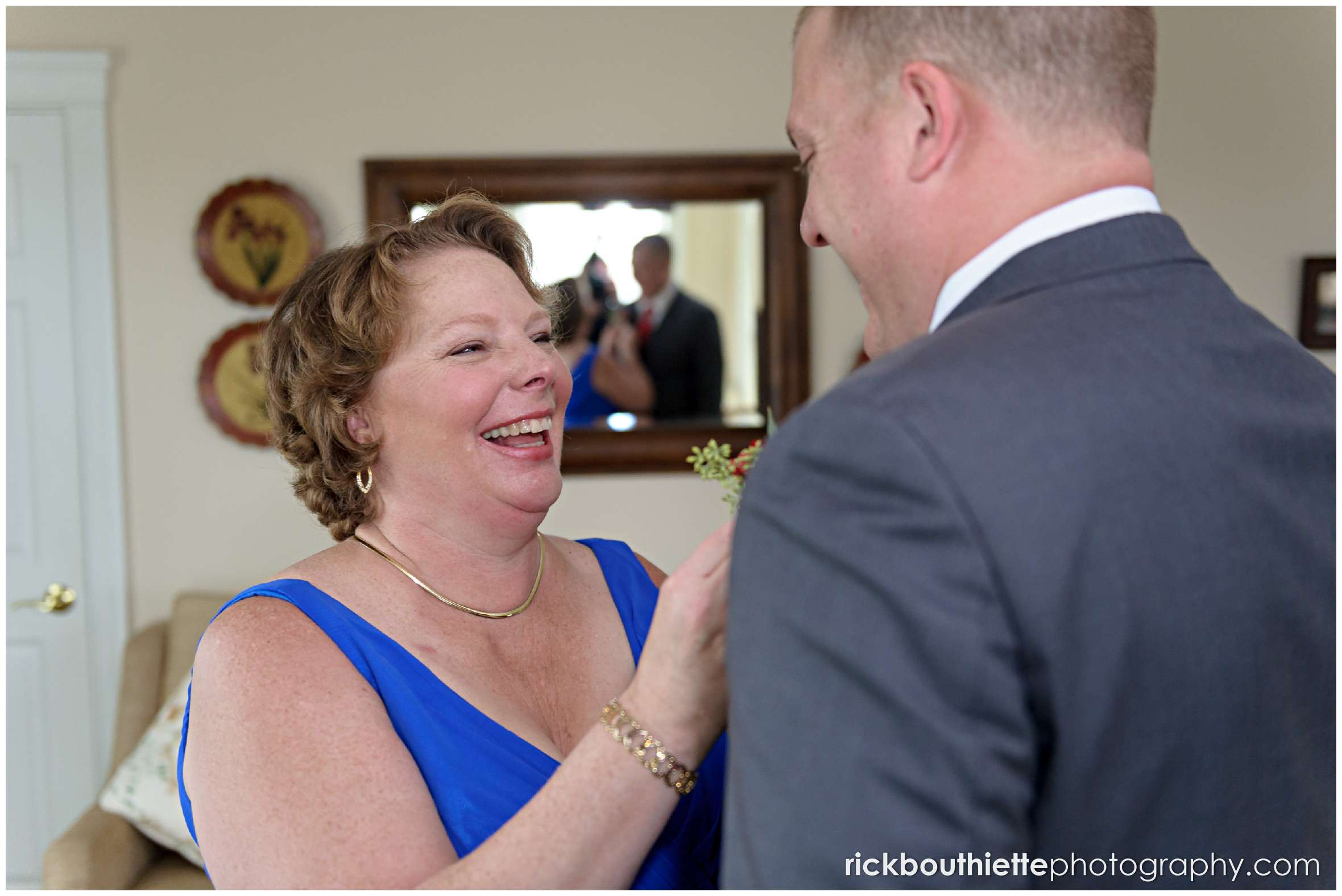groom's mother helping him with final details at mountain view grand wedding