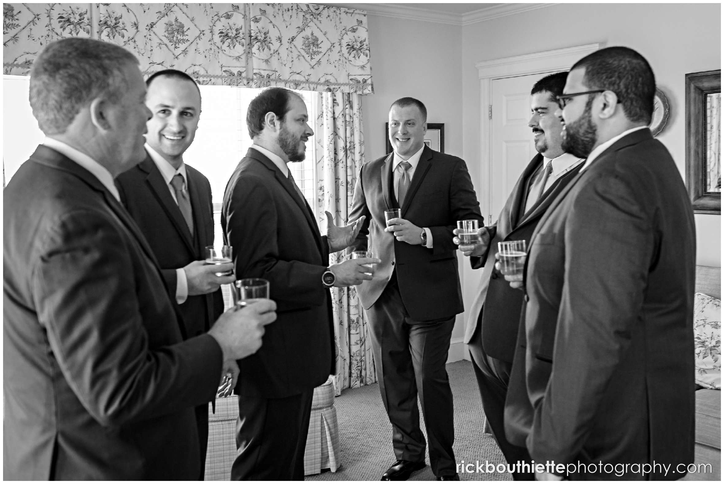 the groom and his groomsmen enjoy a shot before his wedding ceremony at the mountain view grand resort