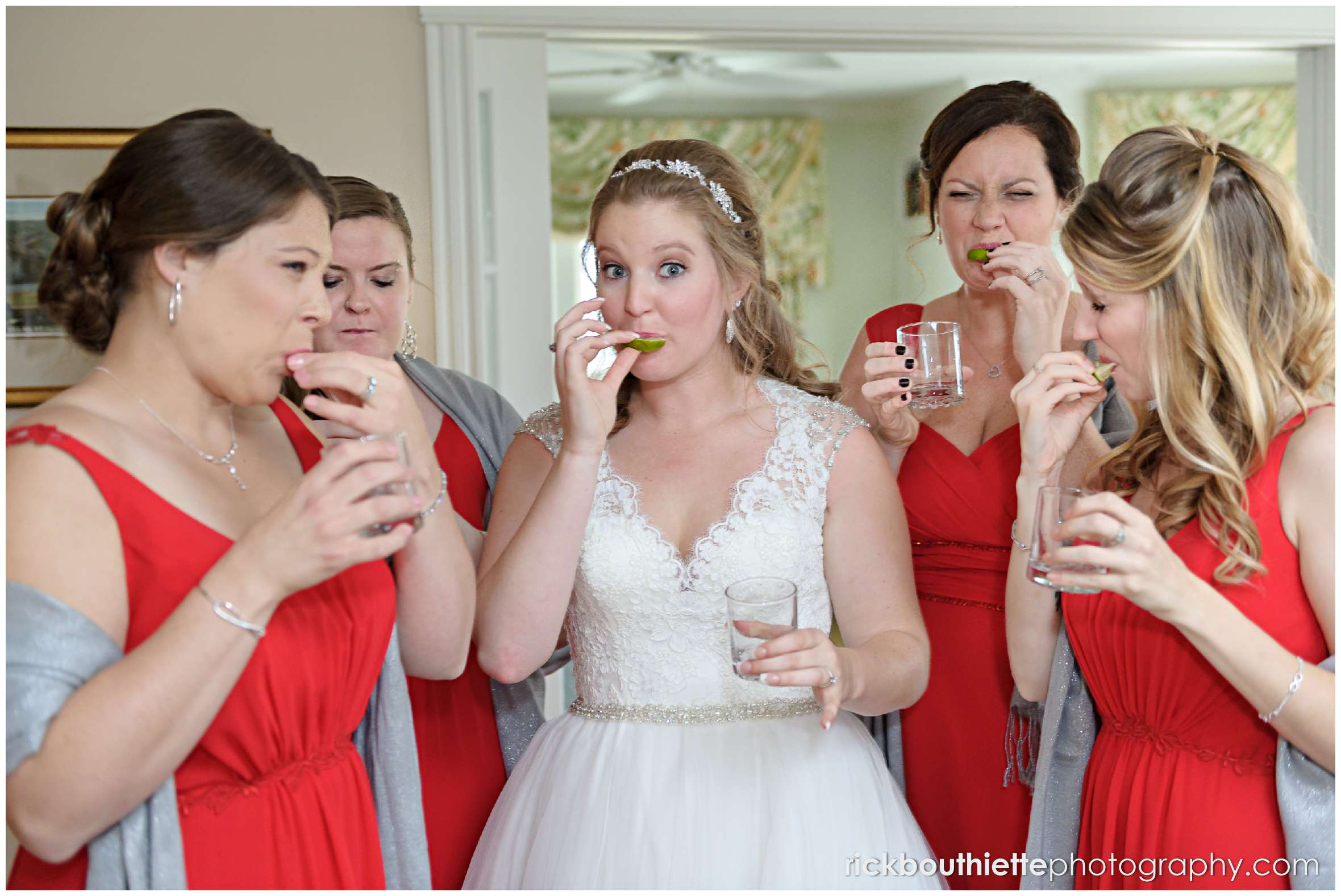 the bride and her bridesmaids enjoy a shot of tequila before her wedding ceremony at the mountain view grand resort