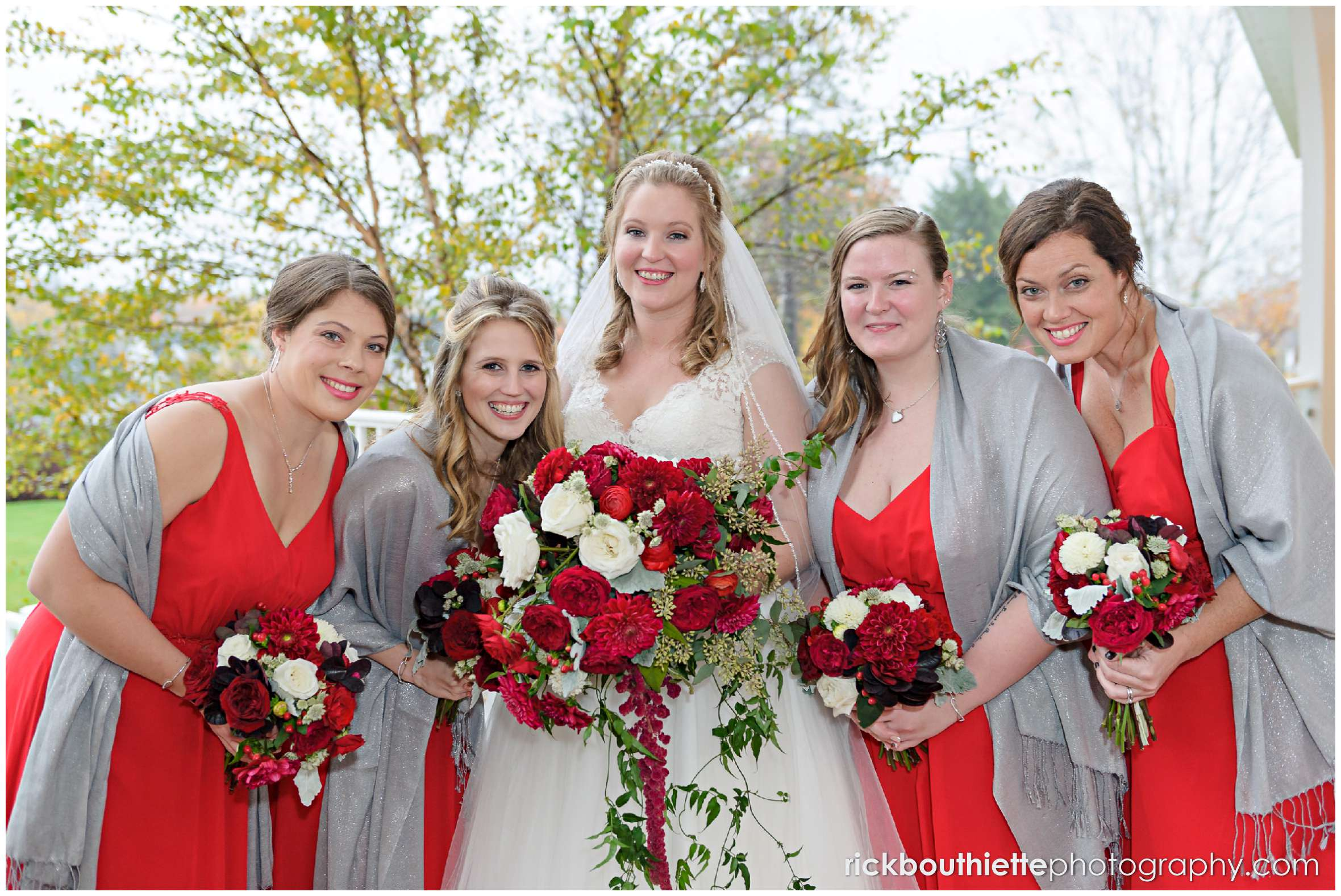 bride and her bridesmaids having a little fun at mountain view grand resort wedding
