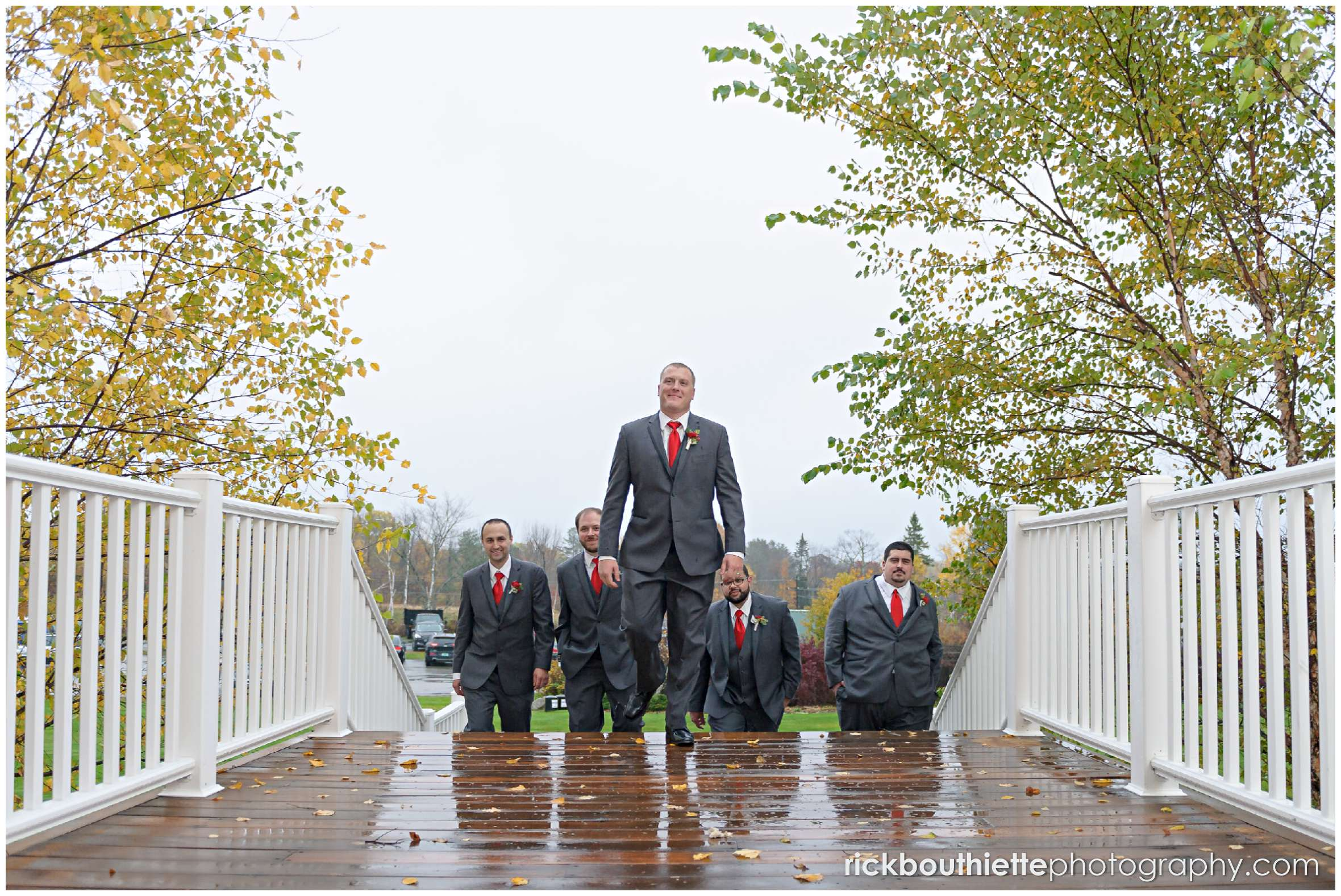 the groom and his groomsmen coming up the stairs at mountain view grand resort