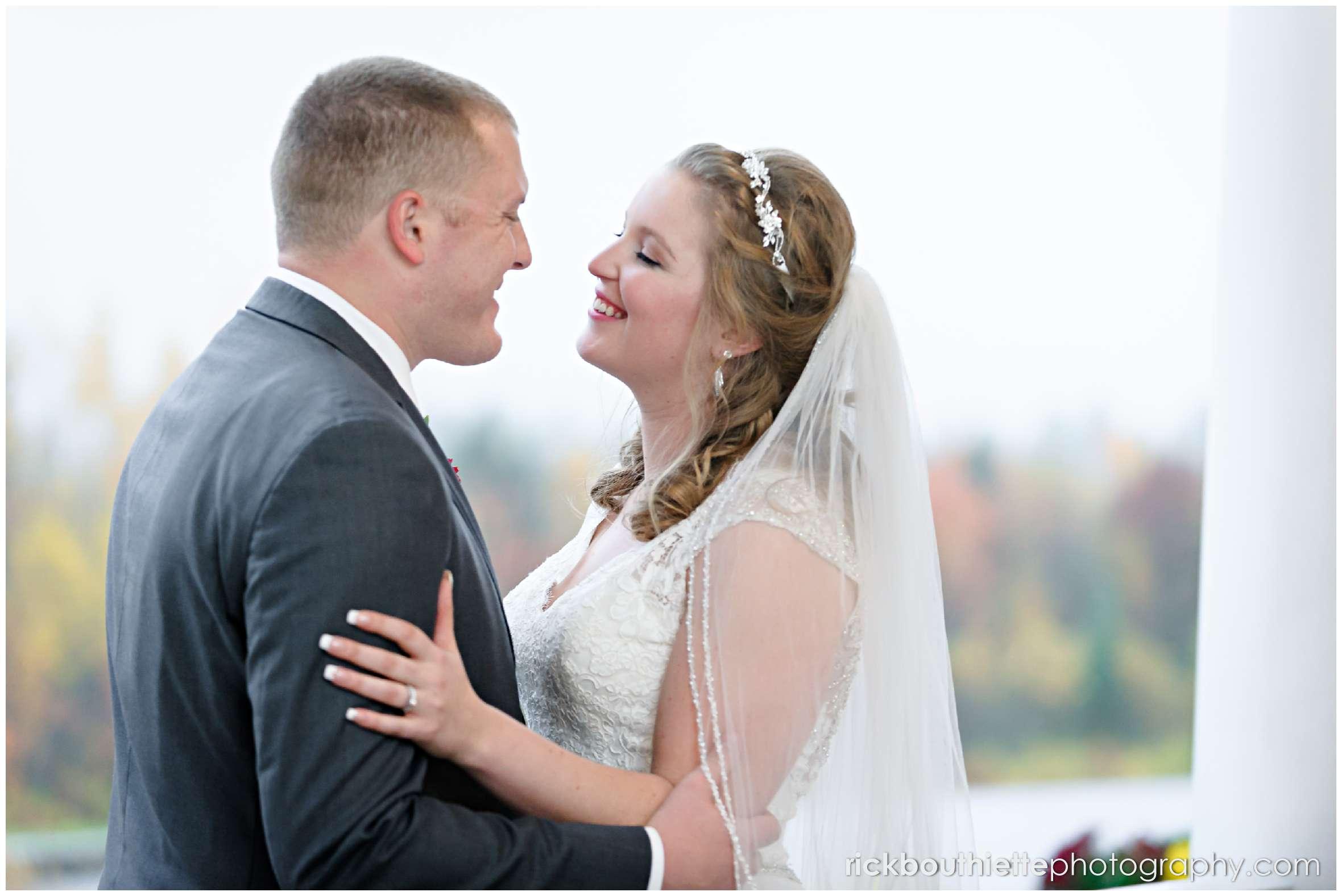 bride and groom on veranda at mountain view grand resort
