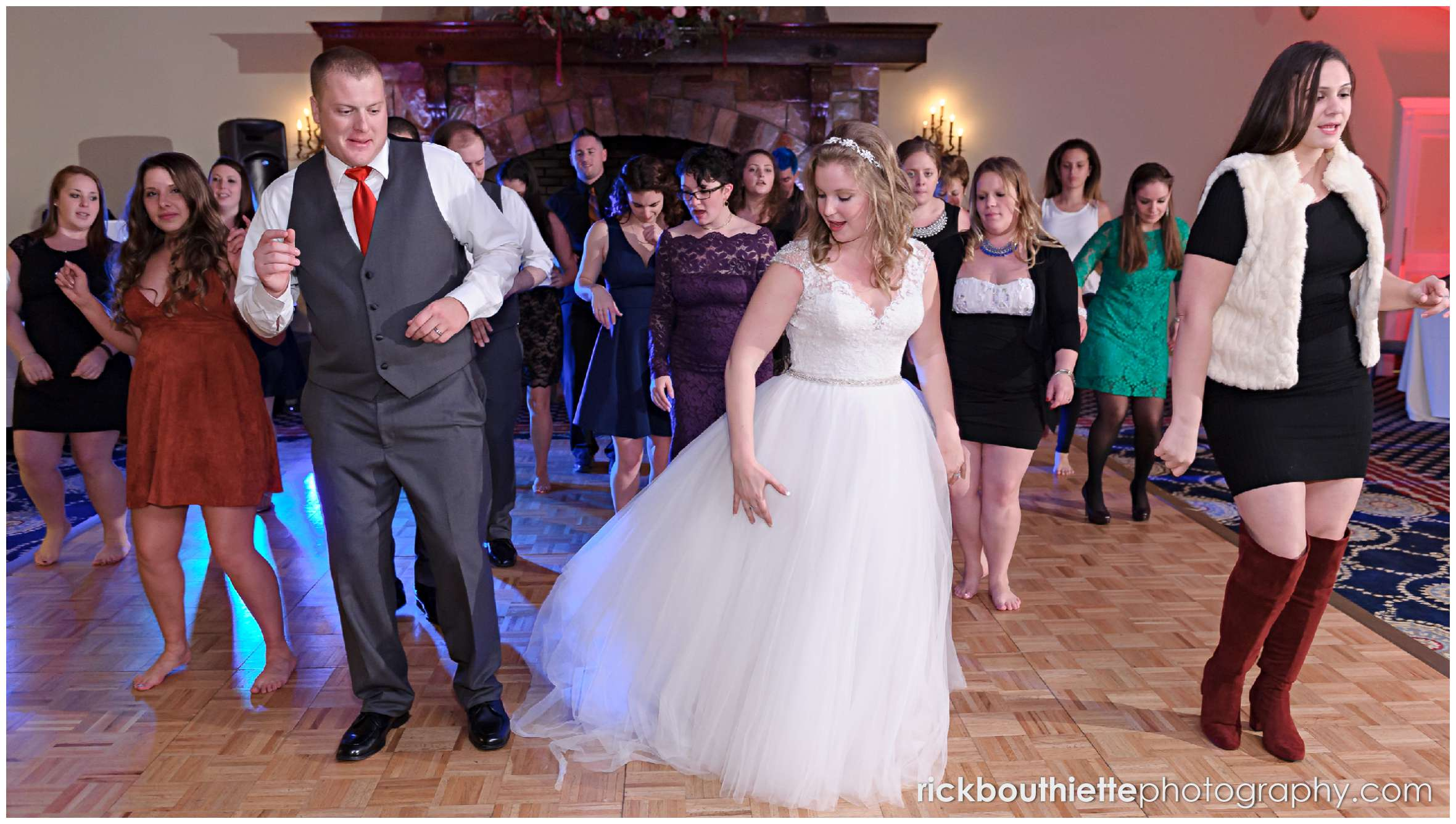 bride and groom dancing with guests in Presidential Promenade wedding