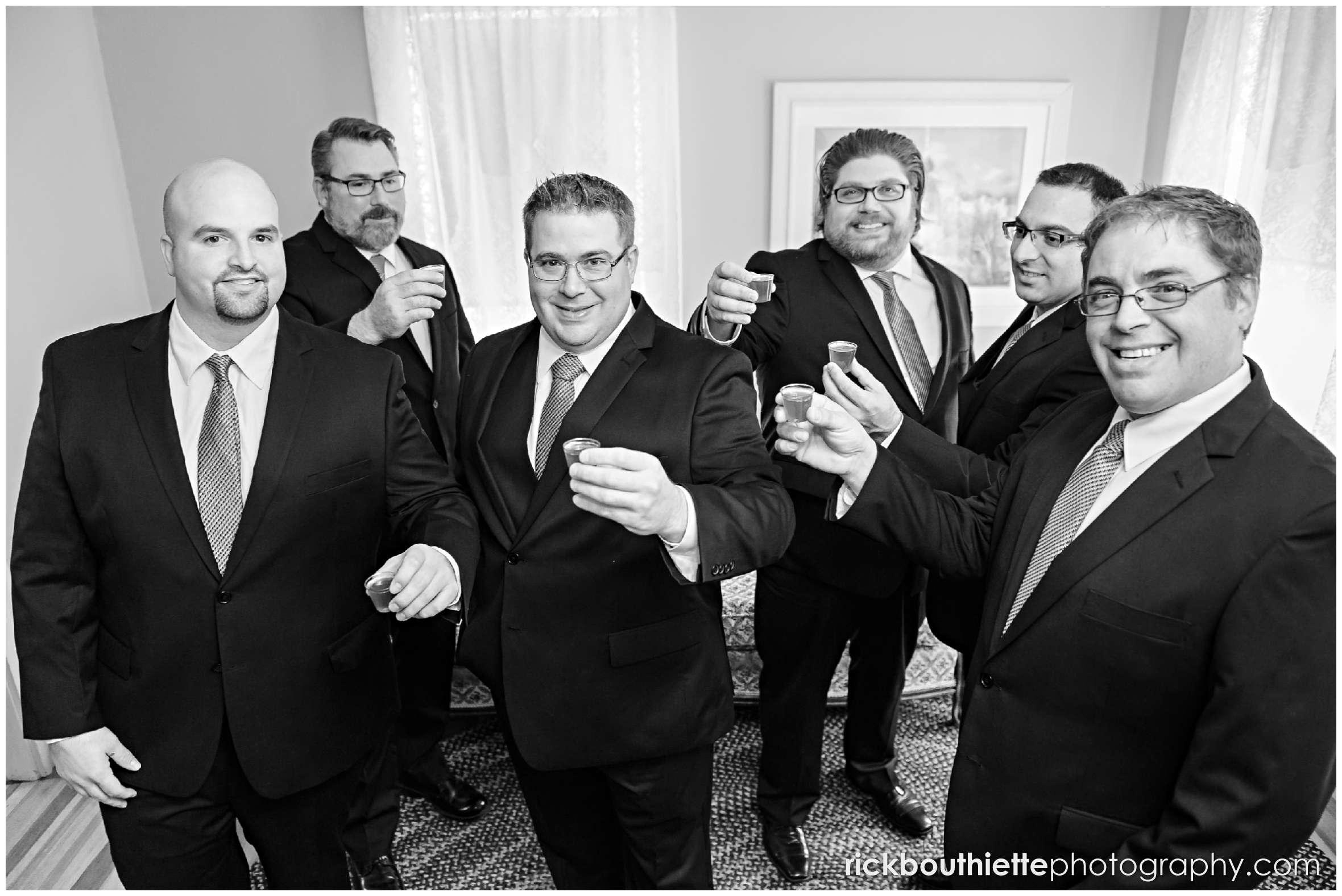 groom and groomsmen celebrate before seacoast wedding