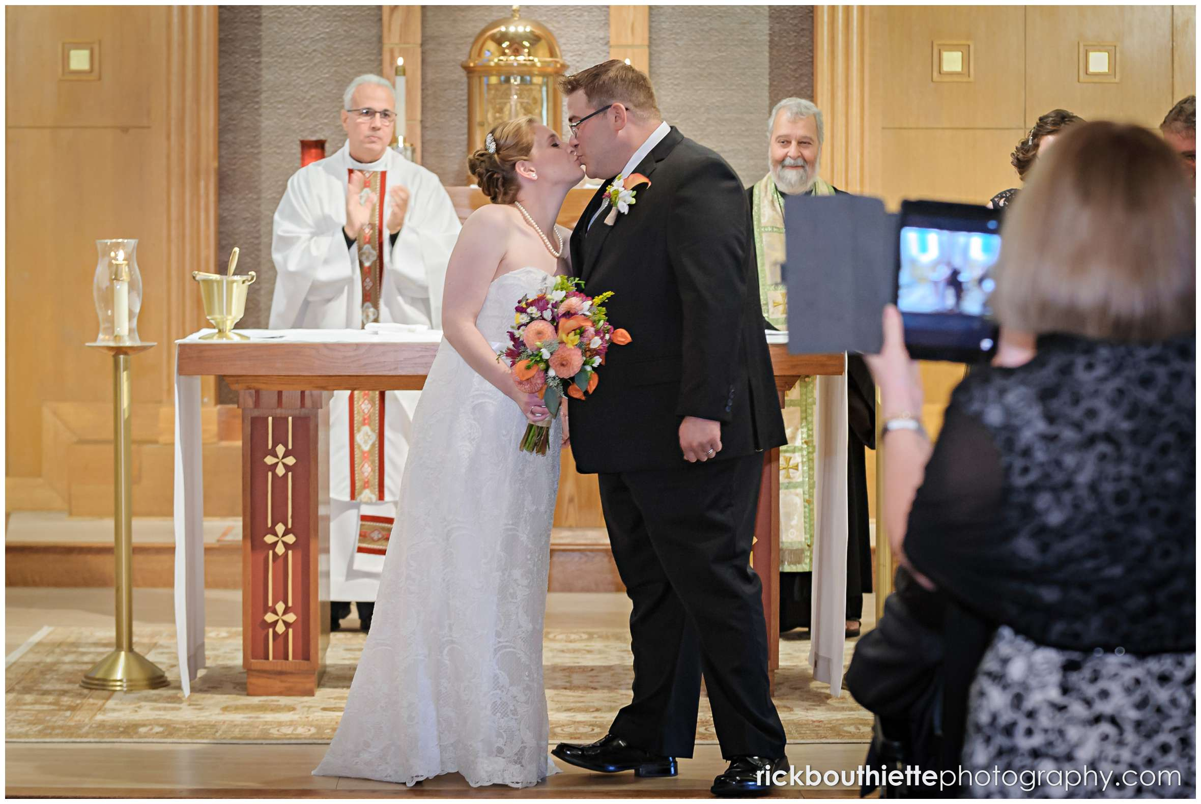 bride and groom kiss at seacoast wedding ceremony
