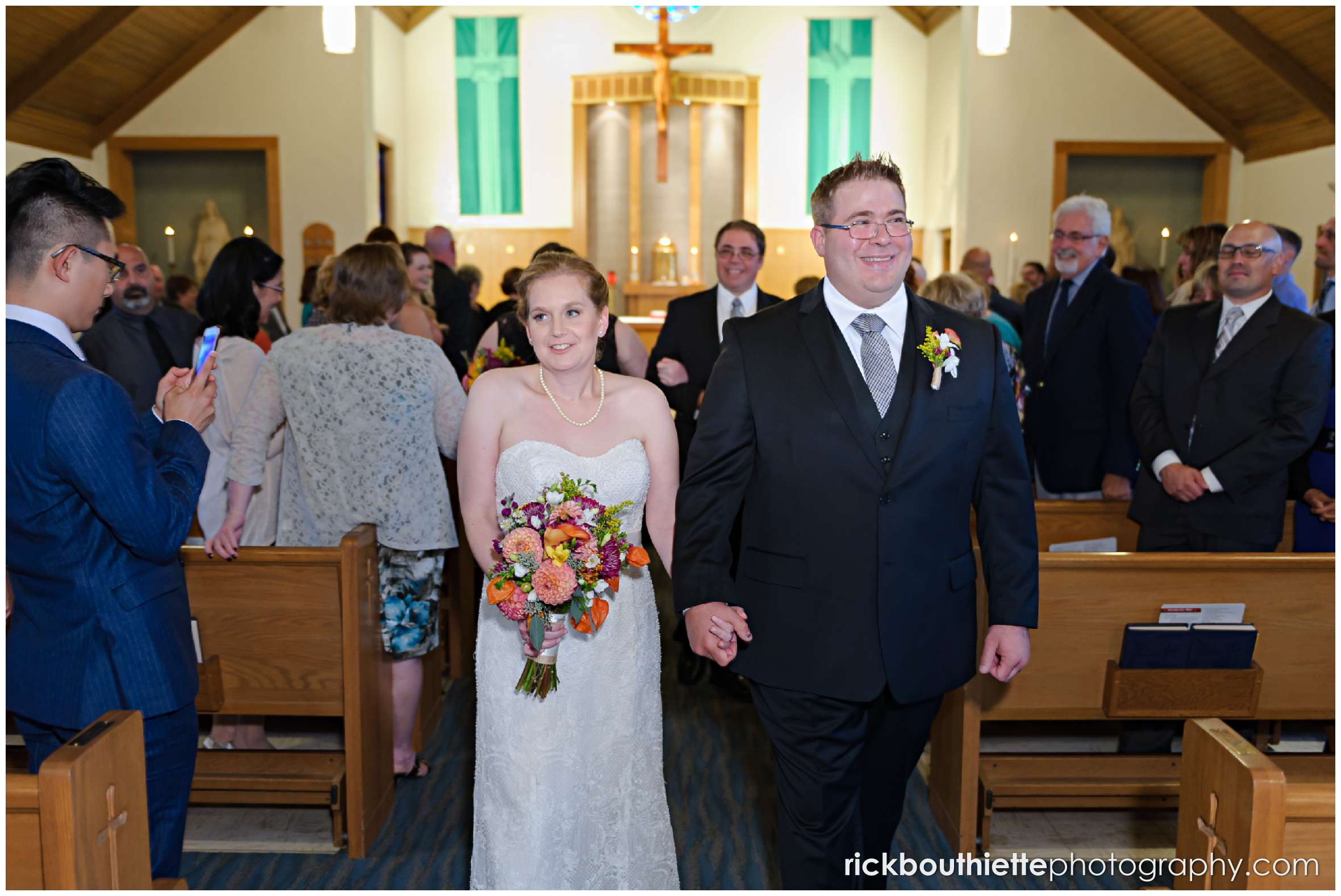 bride and groom walking down aisle after New Hampshire seacoast wedding ceremony