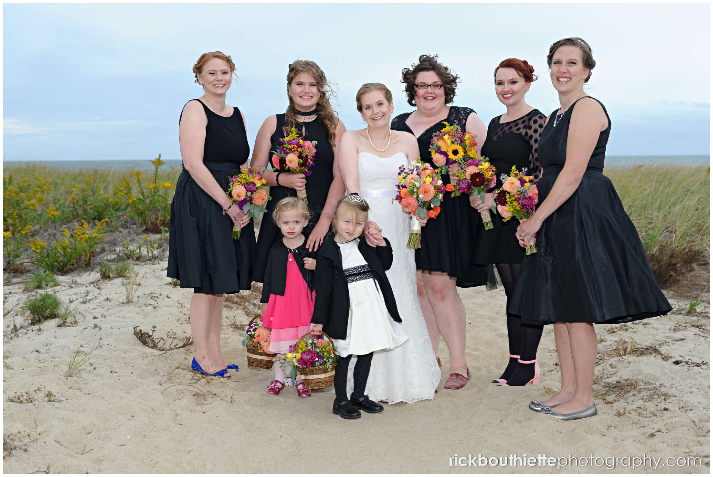 bride and bridesmaids on Seabrook beach after seacoast wedding ceremony