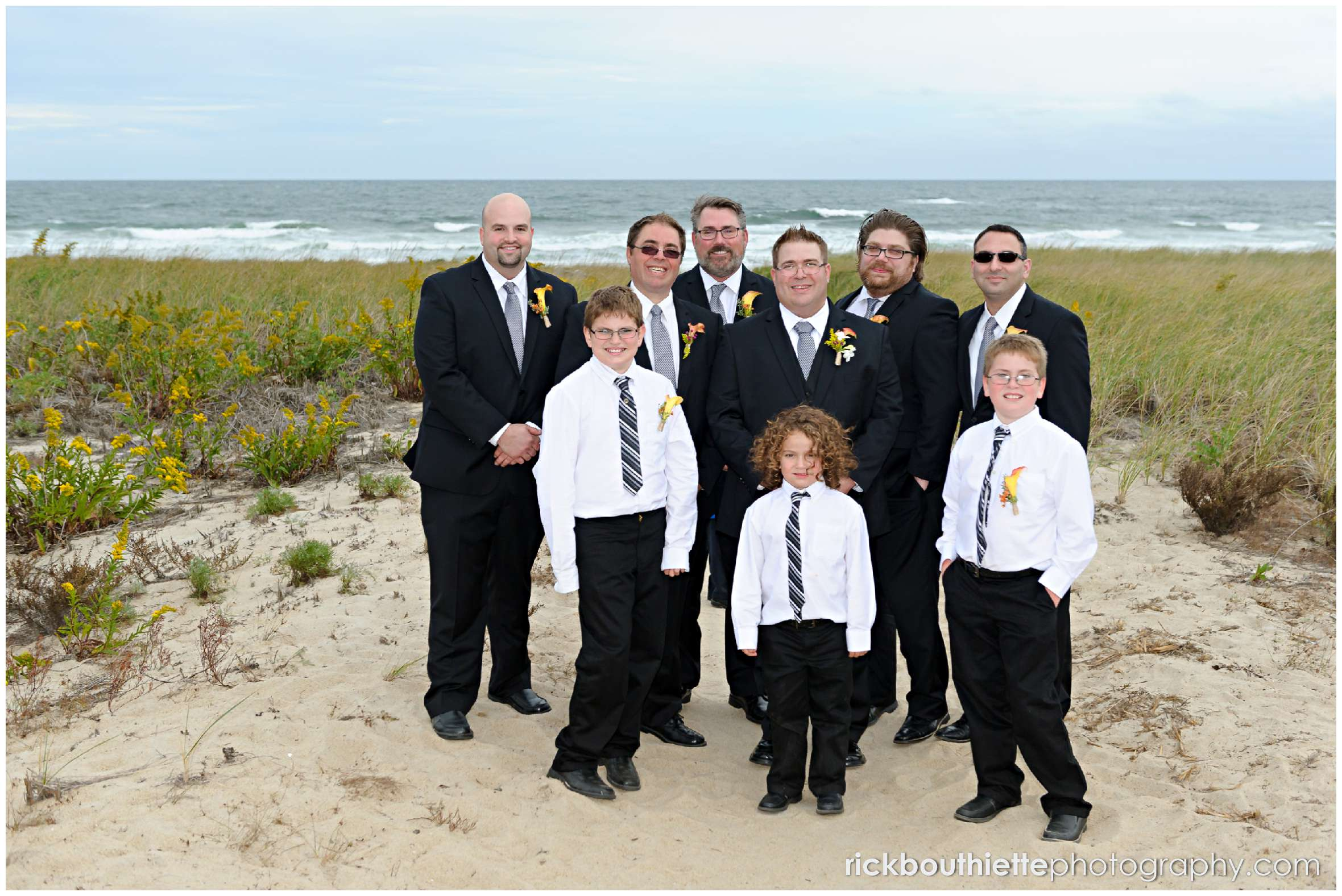 groom and groomsmen on beach after Seabrook NH seacoast wedding