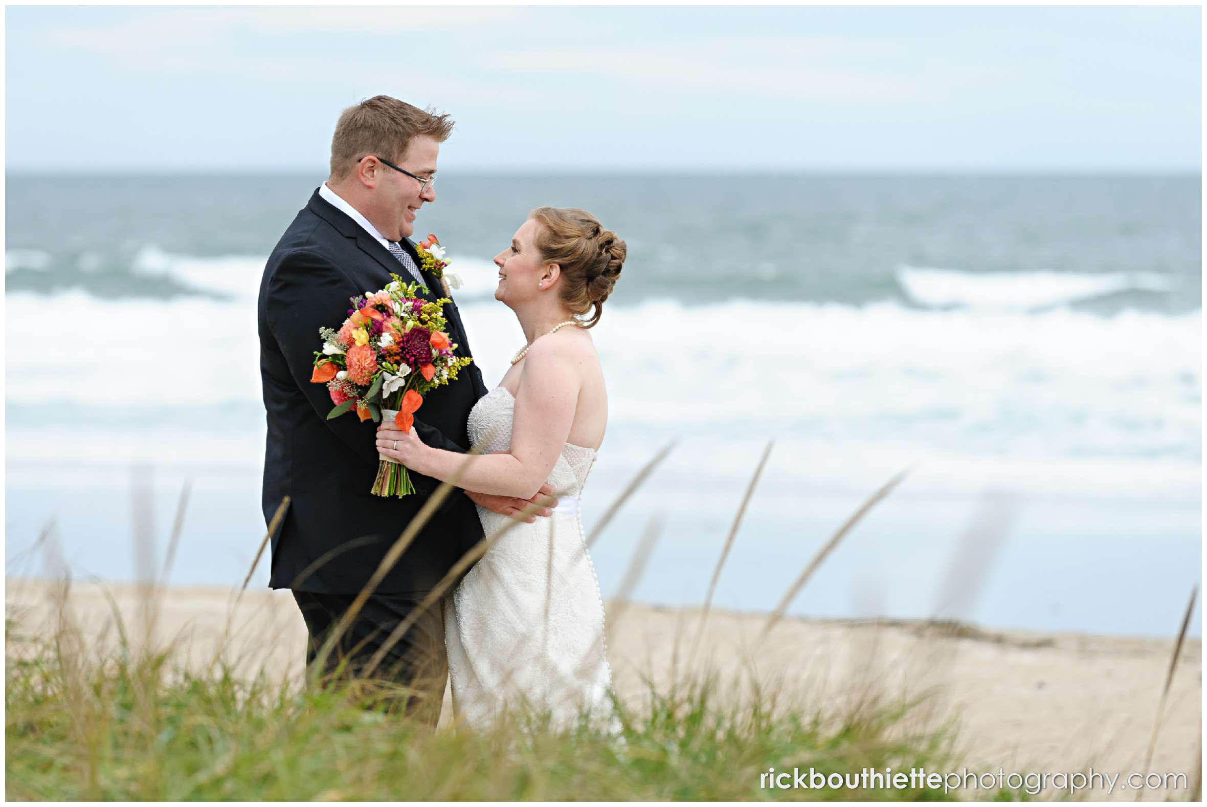 bride and groom spend time on Seabrook beach after their seacoast wedding ceremony