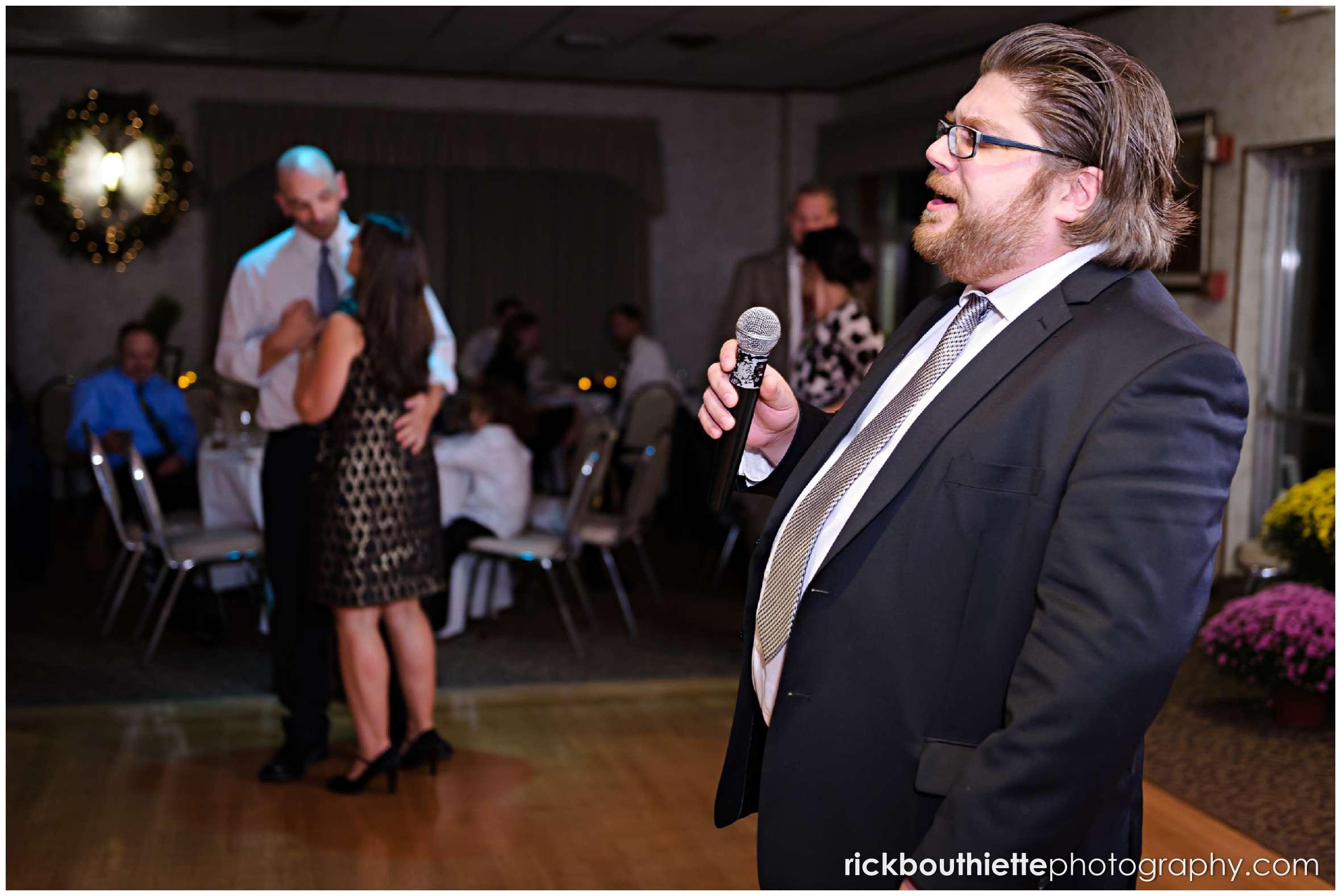 groomsman singing at New Hampshire seacoast wedding