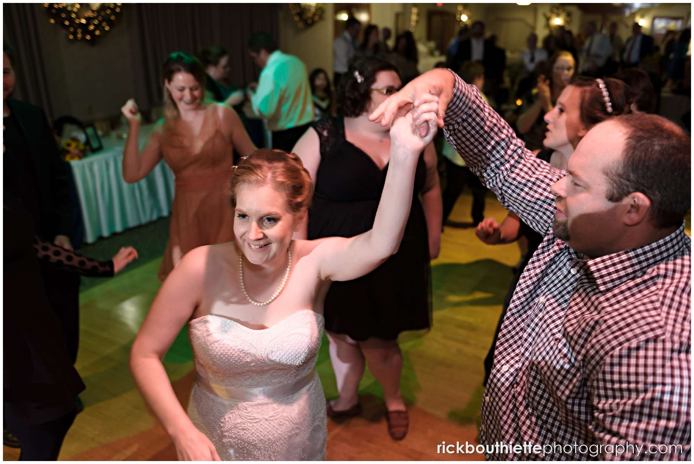 bride dancing with guests at New Hampshire seacoast wedding