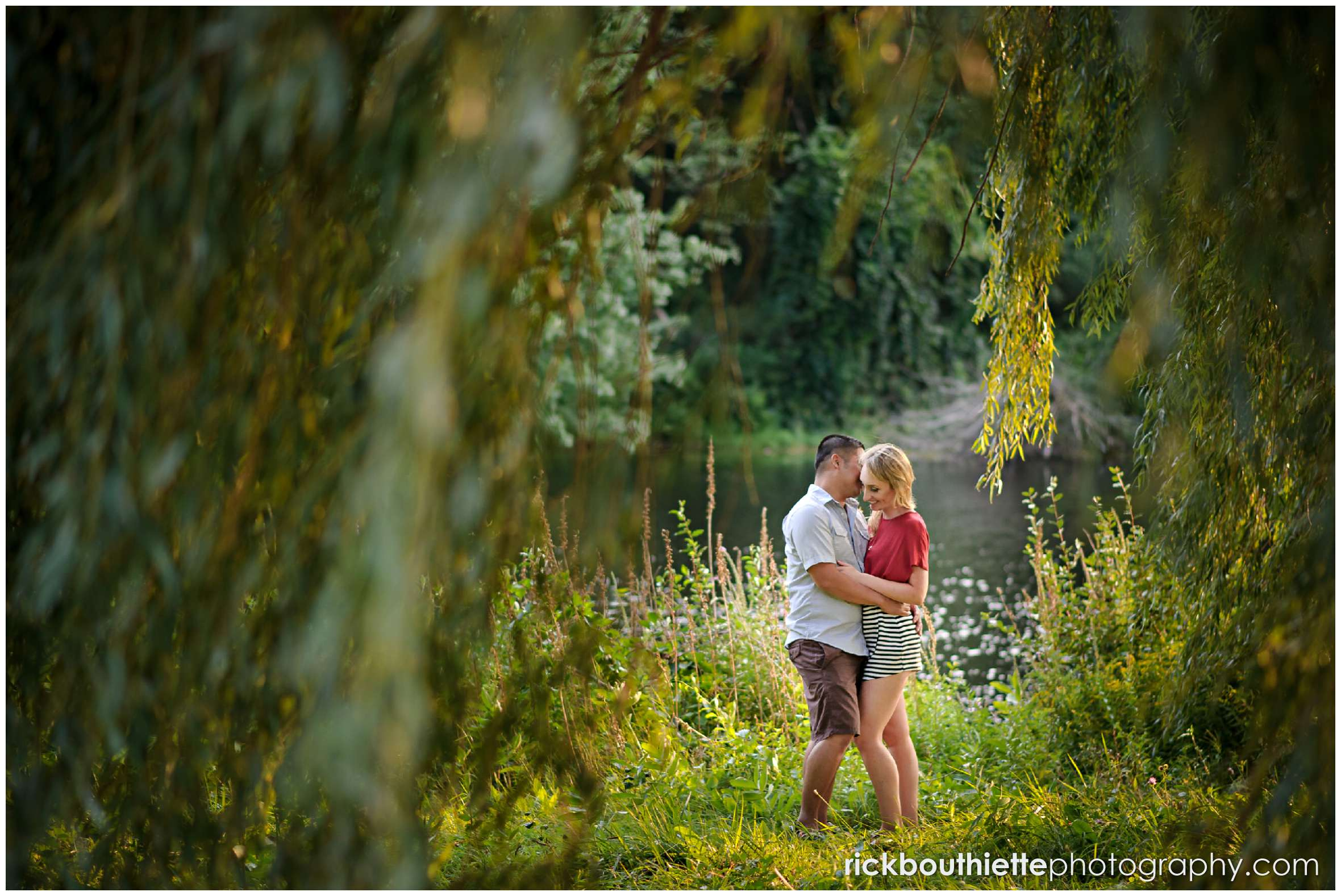 Couple sharing a romantic moment at apple orchard engagement session