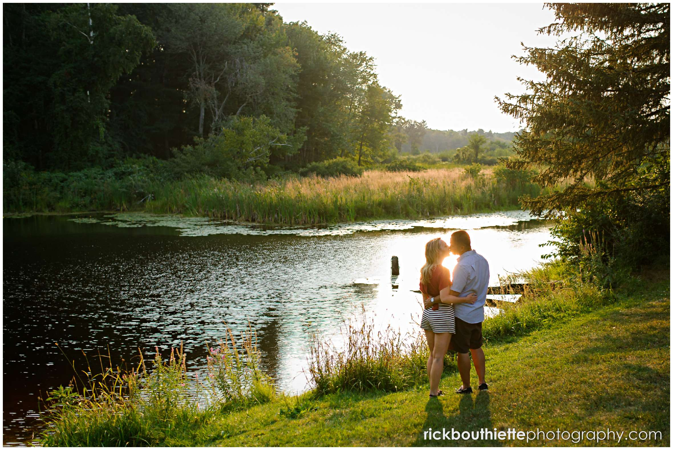silhouette of couple by the pond at apple orchard engagement session
