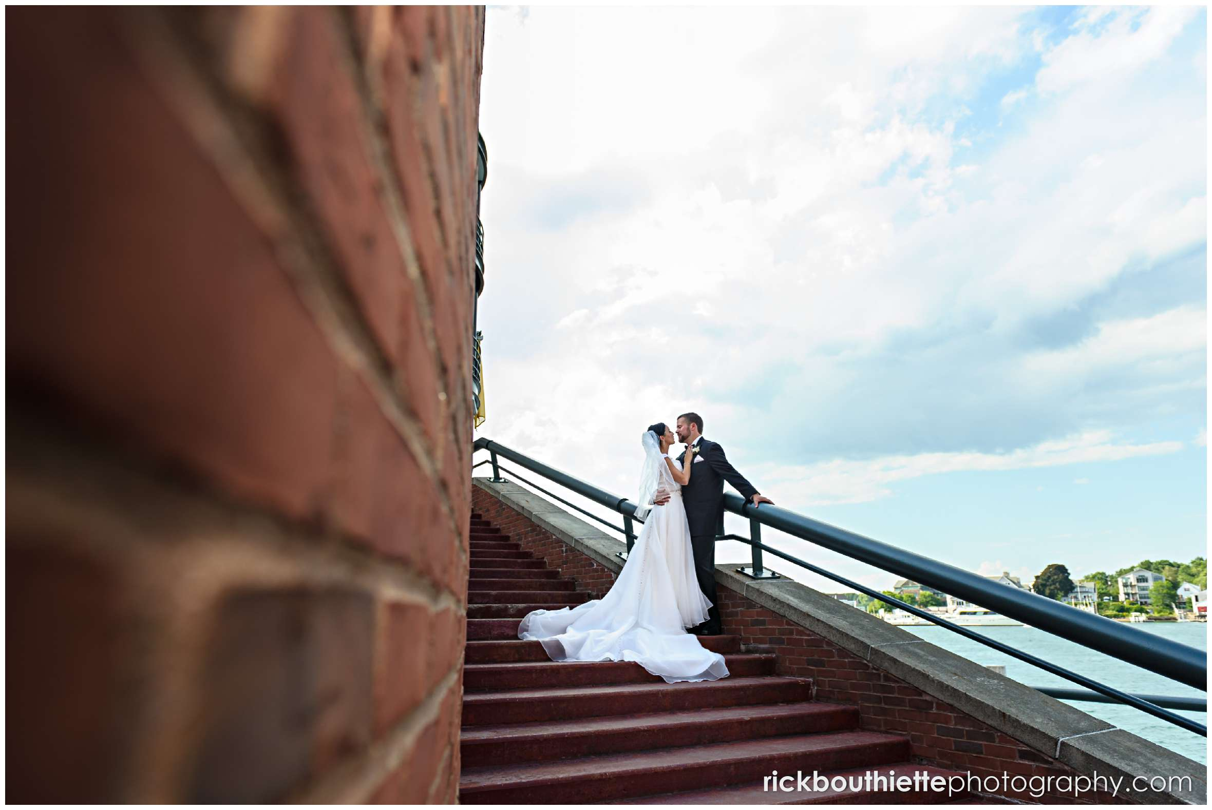bride and groom on stairs in Portsmouth New Hampshire seacoast