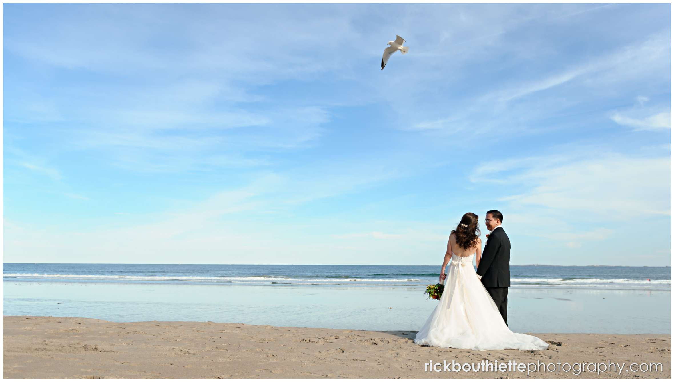 bride and groom on the beach in Rye New Hampshire at Surf Club wedding