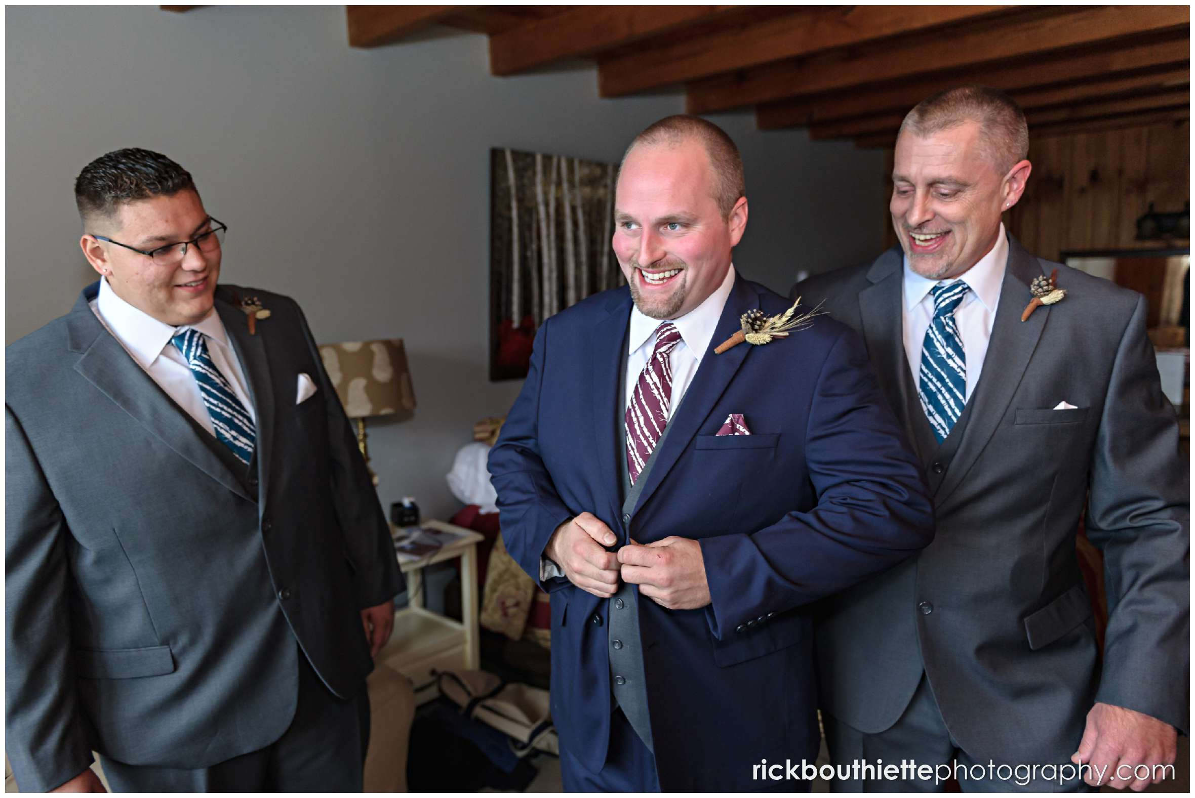happy groom and his groomsmen getting ready for a Snowvillage Inn fall wedding