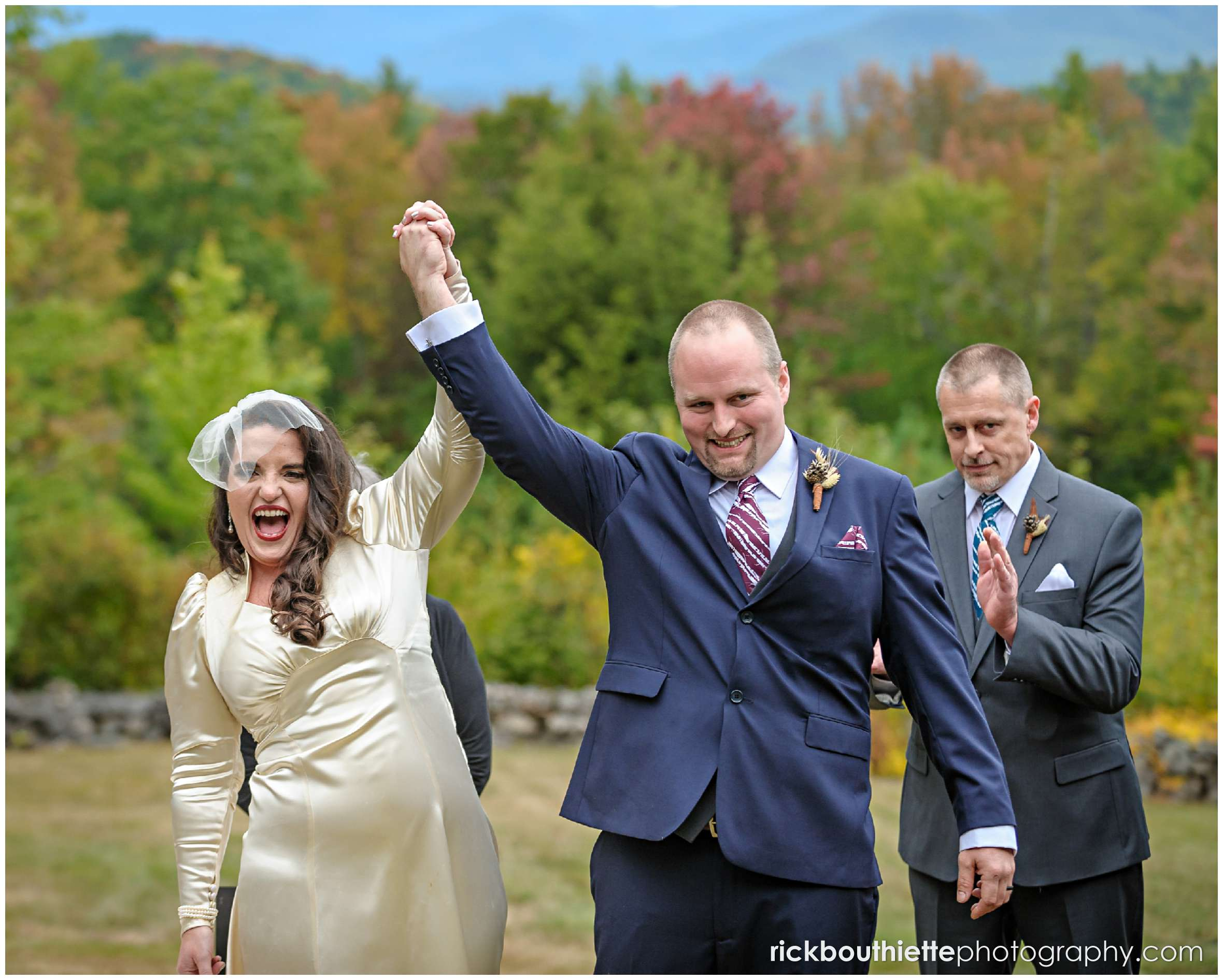 happy bride and groom celebrate as they walk down the aisle after their wedding ceremony