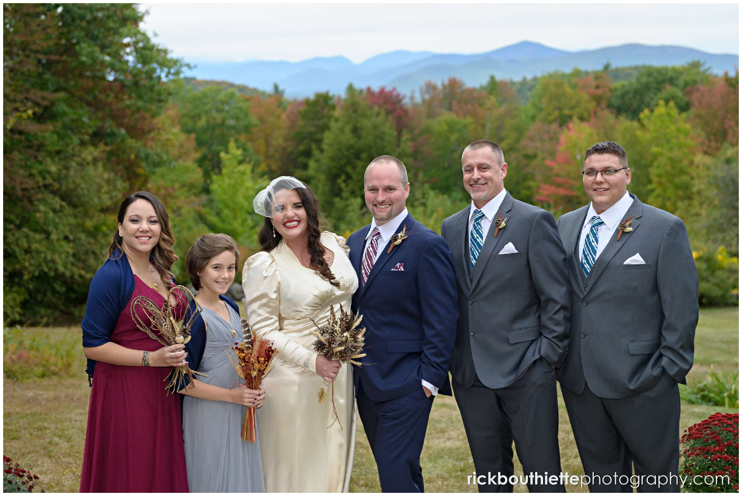 wedding party with fall foliage in background at Snowvillage Inn wedding