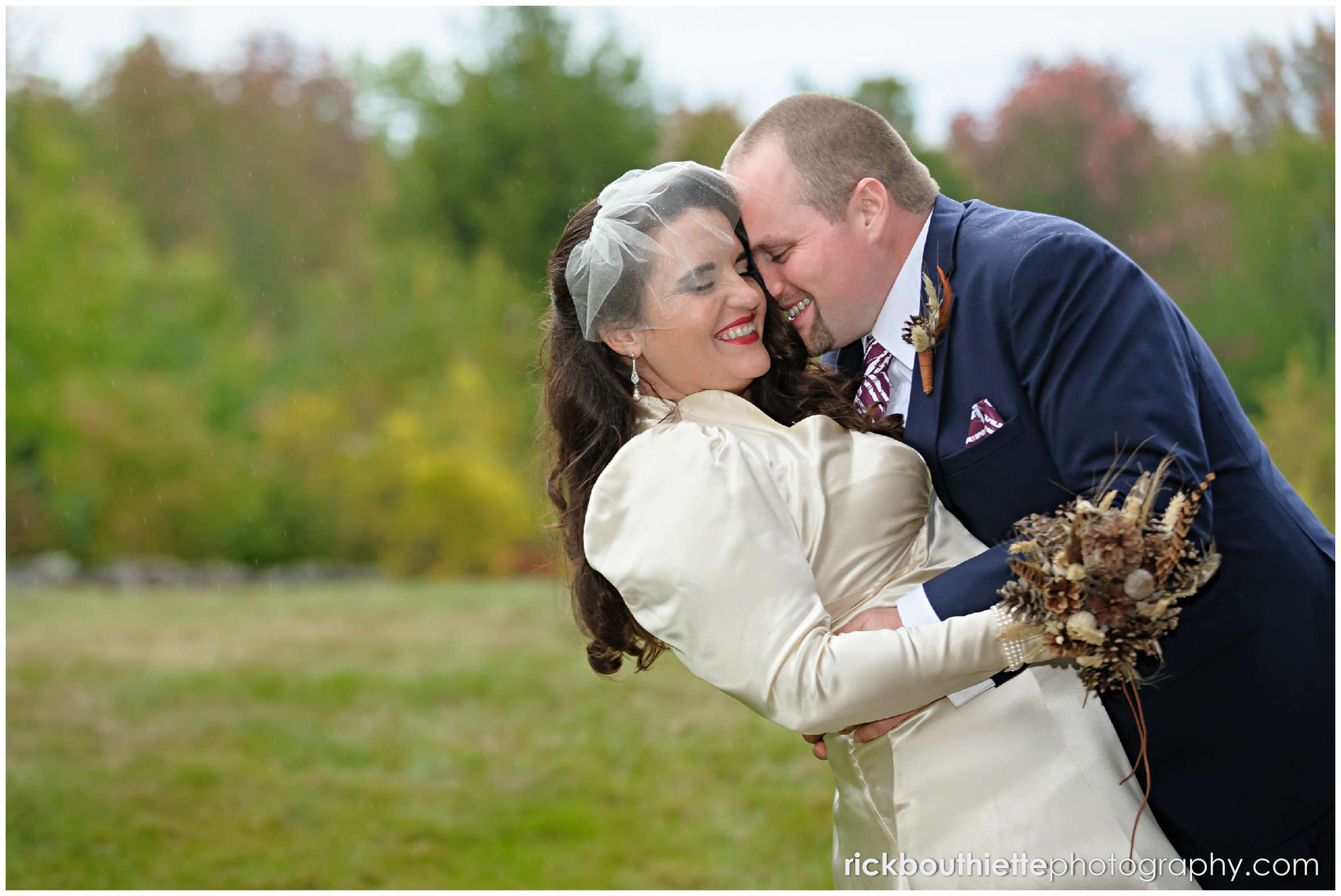 bride and groom laughing as they embrace at Snowvillage Inn fall wedding