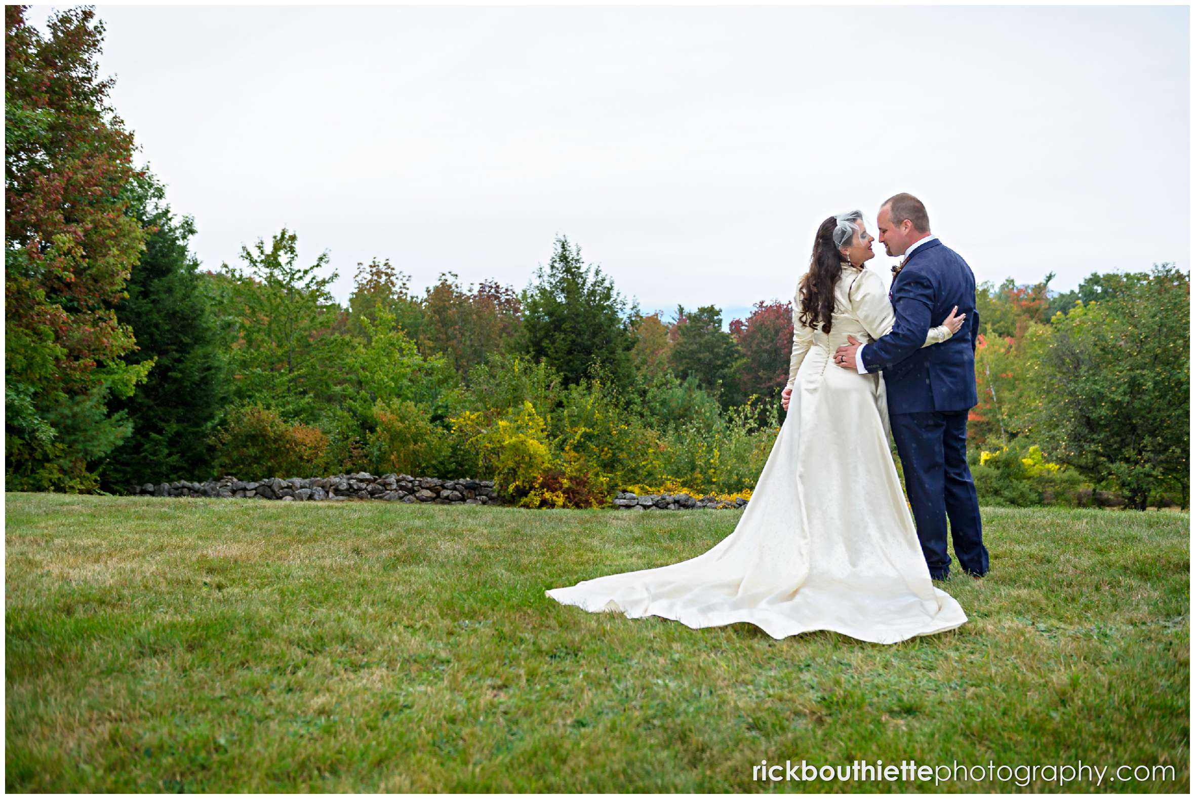 bride and groom enjoying the fall foliage after their wedding ceremony
