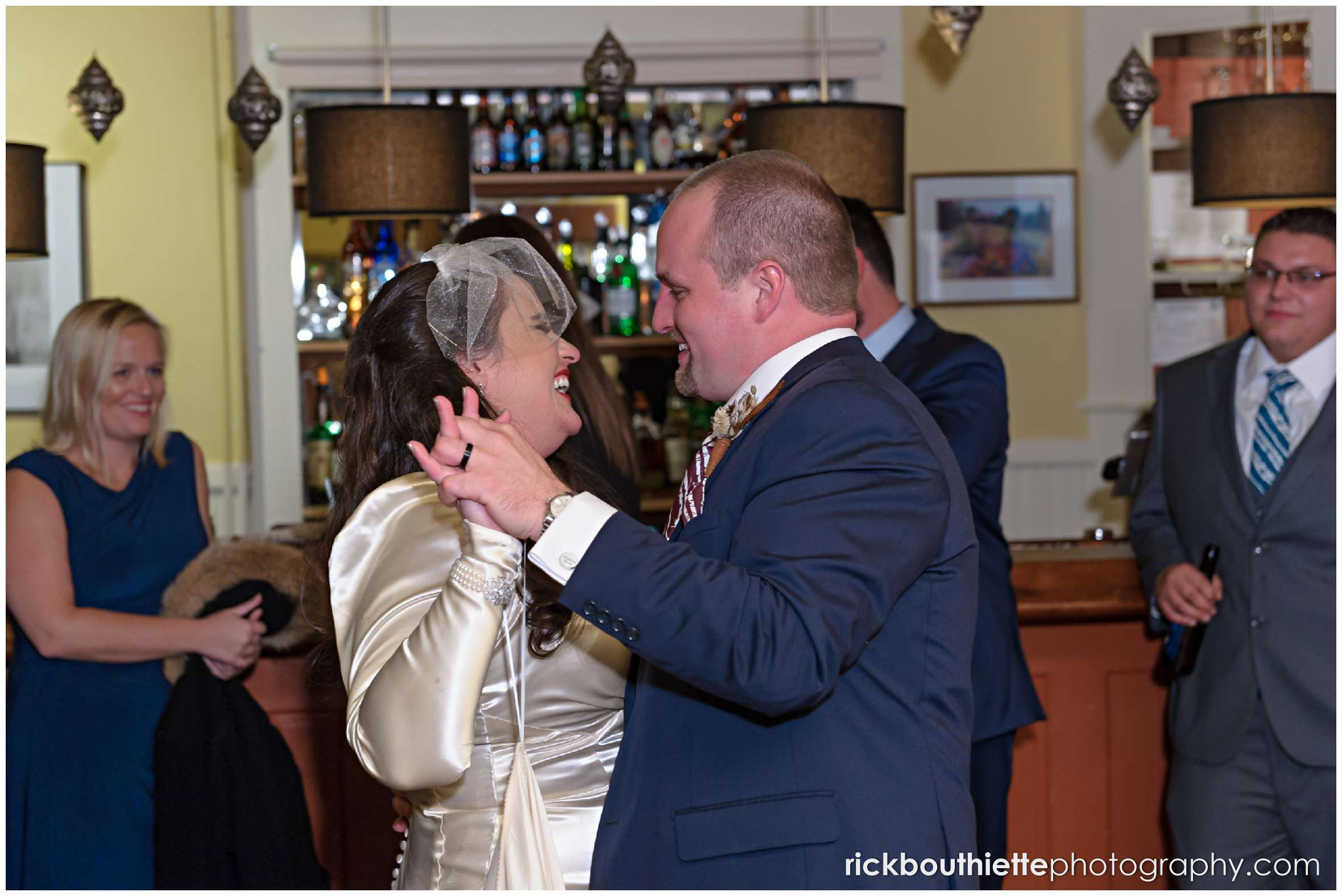 bride and groom have their first dance in the bar at their Snowvillage Inn wedding