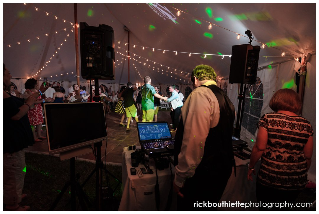 Behind The Scenes Of Dj With Guests Dancing At New Hampshire Backyard Summer Wedding Reception Party